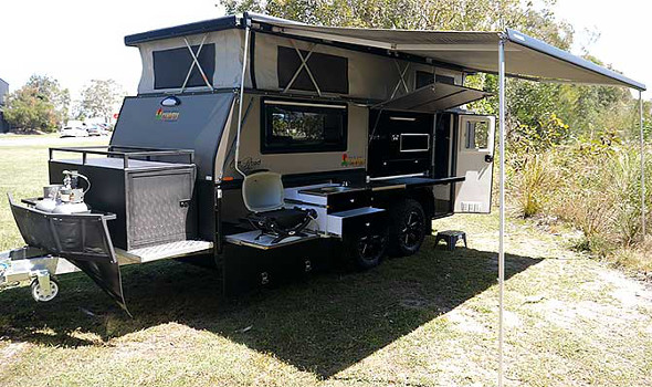 15ft titanium tandem axel camper trailer with awning out